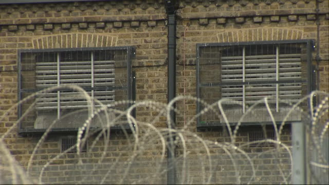 exterior shots of brixton prison with razor wire topped perimeter fence guard towers and bars on cell windows on 10 july 2019 in london united kingdom - shaving equipment stock videos & royalty-free footage