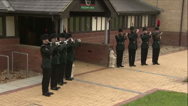 stockvideo's en b-roll-footage met exterior shots of buglers outside the officers mess playing a fanfare as camilla duchess of cornwall arrives to visit normandy barracks>> on november... - aldershot