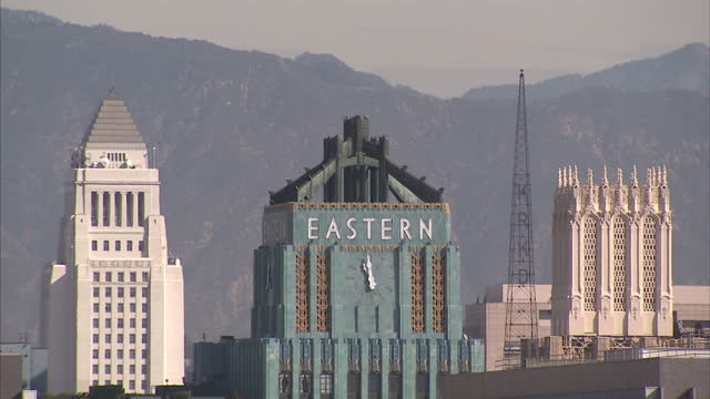 exterior shots of buildings on the los angeles skyline including the los angeles convention center the eastern columbia building and the one wilshire... - columbia center stock videos & royalty-free footage
