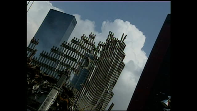 exterior shots of bulldozers and workers clearing debris at ground zero as smoke rises from the debris on september 24 2001 in new york city - petronas twin towers stock-videos und b-roll-filmmaterial