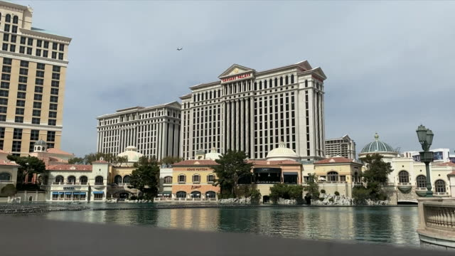 exterior shots of caesars palace hotel casino complex with ornamental lake in front on 28 february 2020 in las vegas, nevada - the strip las vegas stock videos & royalty-free footage