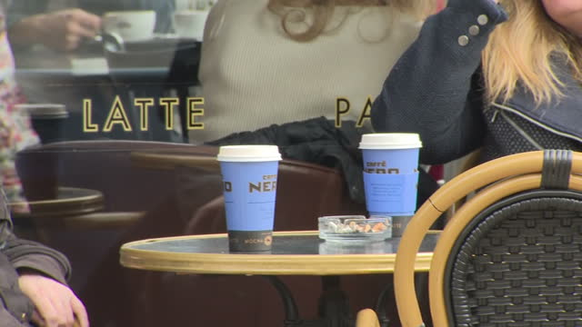 exterior shots of cafe nero coffee shop and people sitting outside of it drinking out of disposable cups on march 30 2017 in london england - disposable stock videos and b-roll footage