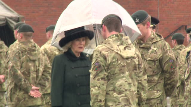 exterior shots of camilla duchess of cornwall meeting soldiers from the 4th battalion the rifles, recently returned from deployment in iraq on... - aldershot stock videos & royalty-free footage