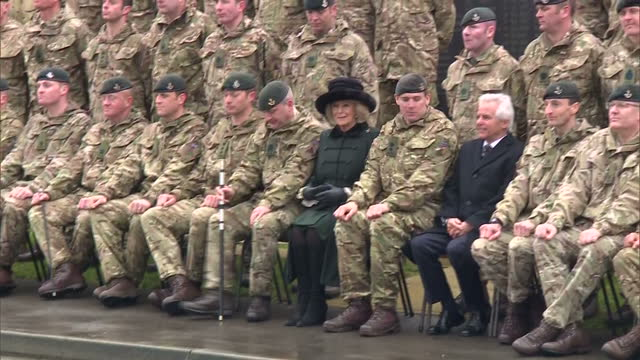 exterior shots of camilla duchess of cornwall posing for a group photograph with members of the 4th battalion the rifles during a visit to normandy... - aldershot stock videos & royalty-free footage