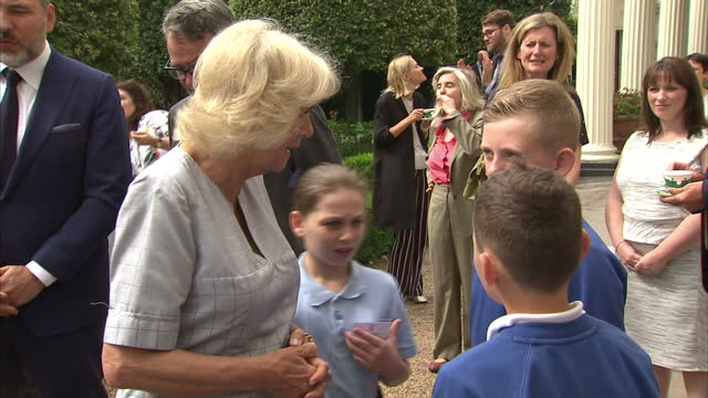 Exterior shots of Camilla Duchess of Cornwall speaking to schoolchildren during a tea party at Clarence House to celebrate the Duchess' Bookshelves...