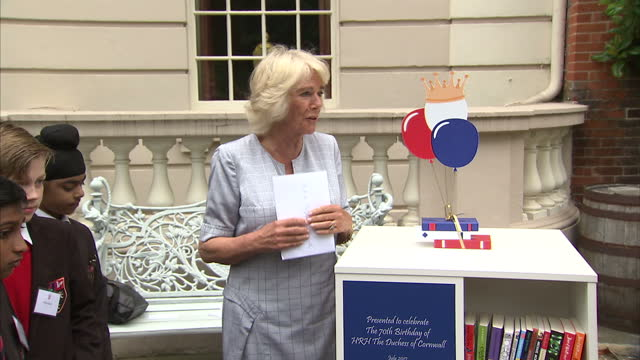 Exterior shots of Camilla Duchess of Cornwall thanking Dame Julia Cleverdon Chair of the Children's Literacy Trust and other guests for the...