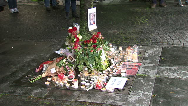 exterior shots of candles flowers and photos laid nearby a tree for jo cox mp and ruth davidson stood in crowd for vigil on june 17 2016 in edinburgh... - jo cox politician stock videos and b-roll footage