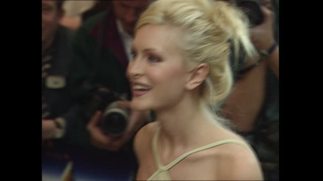exterior shots of caprice bourret at the 'the fifth element' red carpet premiere on 3rd june 1997 in london, england. - film premiere stock videos & royalty-free footage