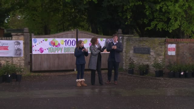 exterior shots of captain moore's family, police and people clapping to mark 100th birthday of captain tom moore and the nhs, carers and key workers... - number 100 stock videos & royalty-free footage
