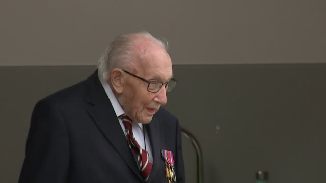 exterior shots of captain tom moore poses for photos after receiving medal from the yorkshire regiment along with his new rank of colonel to mark his... - captain tom moore stock videos & royalty-free footage