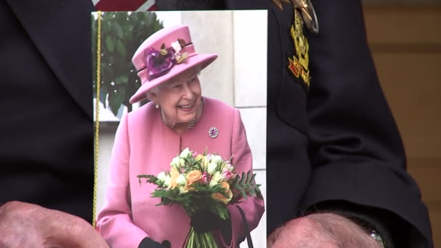 exterior shots of captain tom moore posing for photos with card and cake from the queen on the day of his 100th birthday on 30 april 2020 in bedford... - captain tom moore stock videos & royalty-free footage