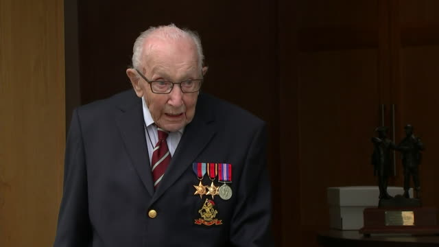 exterior shots of captain tom moore reaction after receiving the yorkshire regiment medal along with his new rank of colonel to mark his 100th... - captain tom moore stock videos & royalty-free footage