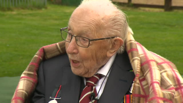 exterior shots of captain tom moore waving as hurricane and spitfires flypast for his 100th birthday on 30 april 2020 in bedford united kingdom - captain tom moore stock videos & royalty-free footage
