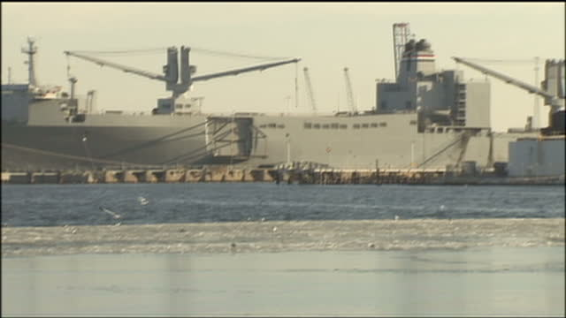 exterior shots of cargo ships moored at the port of baltimore with ice on the surface of the patapsco river>> on january 25 2009 in baltimore maryland - port of baltimore stock videos & royalty-free footage