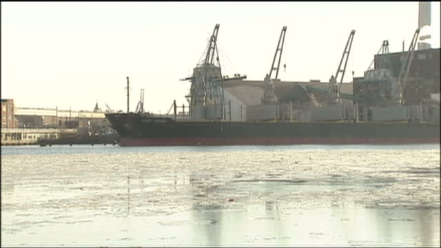 exterior shots of cargo ships moored at the port of baltimore with ice on the patapsco river>> on january 25 2009 in baltimore maryland - port of baltimore stock videos & royalty-free footage