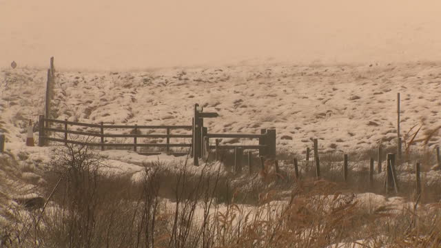 Exterior shots of cars driving along a rural road including views of snow covering Saddleworth Moor on November 26 2017 in Oldham England