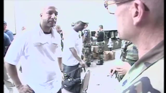 exterior shots of cars stranded in flooded streets, new orleans mayor ray nagin visiting a damaged area hit by hurricane katrina and a crushed car... - gestrandet stock-videos und b-roll-filmmaterial