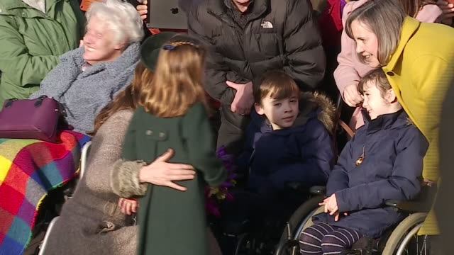 exterior shots of catherine duchess of cambridge and her daughter princess cherlotte talking to royal fans after church on christmas day on 25th... - charlotte stock-videos und b-roll-filmmaterial