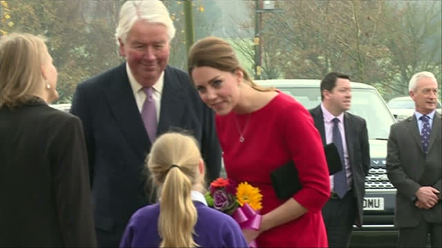exterior shots of catherine, duchess of cambridge arriving at the royal norfolk showground and receiving a bouquet of flowers from two local... - east anglia stock-videos und b-roll-filmmaterial