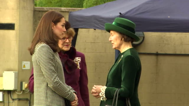 exterior shots of catherine duchess of cambridge getting out of royal car wearing a black and white reiss coat greet officials of the action on... - duchess of cambridge stock videos and b-roll footage