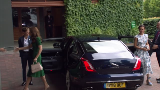 Exterior shots of Catherine Duchess of Cambridge in a green Dolce and Gabbana dress arriving with her sister Pippa Middleton at Wimbledon ahead of...