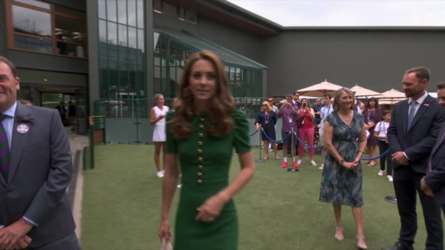exterior shots of catherine, duchess of cambridge in a green dolce and gabbana dress chatting with people ahead of the women's singles final, on 13th... - individual event stock videos & royalty-free footage