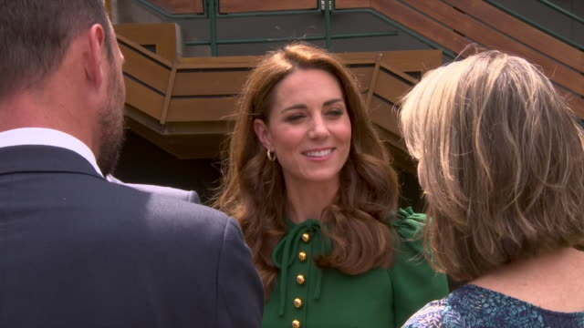 Exterior shots of Catherine Duchess of Cambridge in a green Dolce and Gabbana dress chatting with people ahead of the women's singles final on 13th...