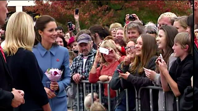 exterior shots of catherine, duchess of cambridge meeting well wishers, shaking hands, bending over to speaking to parents with children on april 10,... - bending over stock videos & royalty-free footage