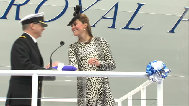 Exterior shots of Catherine Duchess of Cambridge naming cruise liner Princess Royal and launching bottle of champagne to smash on side of ship...