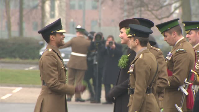 exterior shots of catherine, duchess of cambridge presenting st patrick's day shamrocks to officers and guardsmen of the 1st battalion irish... - aldershot stock videos & royalty-free footage