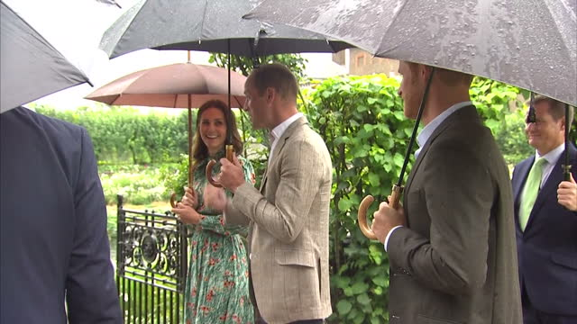 exterior shots of catherine duchess of cambridge prince william duke of cambridge and prince harry being shown round commemorative garden that has... - herzogin stock-videos und b-roll-filmmaterial