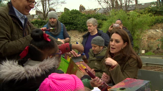 Exterior shots of Catherine Duchess of Cambridge talking to school children while visiting the King Henry's Walk Garden in Islington on 15 January...