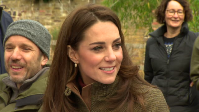 exterior shots of catherine duchess of cambridge talking to school children while visiting the king henry's walk garden in islington and inspecting... - イズリントン点の映像素材/bロール