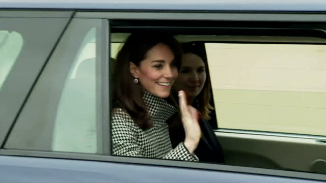 exterior shots of catherine duchess of cambridge waving at screaming children from royal car wearing a black and white reiss coat shots of crowds... - duchess of cambridge stock videos and b-roll footage