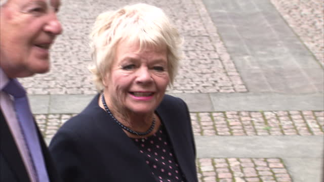 exterior shots of celebrities arriving for a memorial service for sir terry wogan at westminster abbey including judith chalmers with her husband... - terry wogan video stock e b–roll