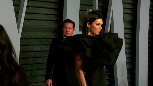 exterior shots of celebrities including kendall jenner armie hammer and elizabeth chambers and calvin harris posing on the red carpet at the vanity... - vanity fair oscar party stock videos & royalty-free footage
