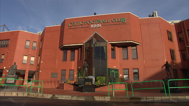 exterior shots of celtic park stadium entrance & stadium interiors & statue of jimmy johnstone at entrance. celtic park will be the venue for the... - 2014 stock-videos und b-roll-filmmaterial