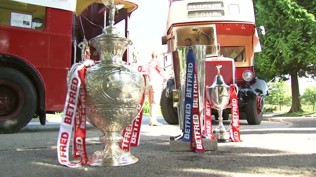 exterior shots of challenge cup trophy, super league trophy and women's challenge cup trophy on the floor in front of the open top buses and being... - double decker bus stock videos & royalty-free footage