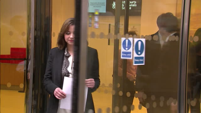 exterior shots of charlotte church walking from high court and giving statement to press after winning case against news international regarding the... - charlotte church stock videos & royalty-free footage