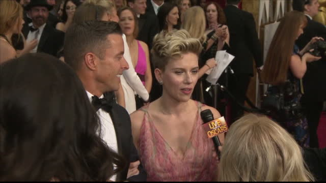 Exterior shots of Charlotte Johansson speaking to reporters on the Oscars red carpet accompanied by her agent Joe Machota on February 26 2017 in Los...