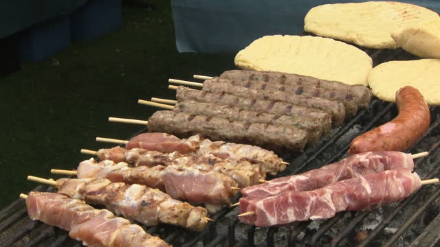 exterior shots of chefs preparing various kebabs or souvlaki on a grill at a food festival on 23 june 2017 in birmingham, united kingdom - greek food stock videos & royalty-free footage