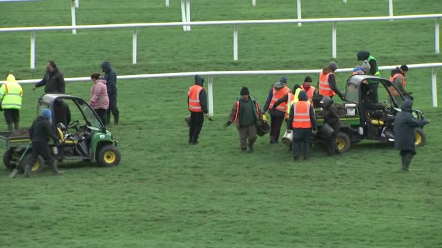 exterior shots of cheltenham race course as groundsmen make preparations to the course and several race horses are walked along on 13 march 2019 in... - cheltenham stock videos & royalty-free footage
