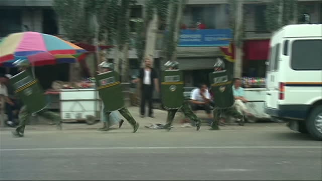 exterior shots of chinese army soldiers with riot shields running on patrol in xinjiang province on may 22 2014 in xinjiang province china - xinjiang province stock videos & royalty-free footage