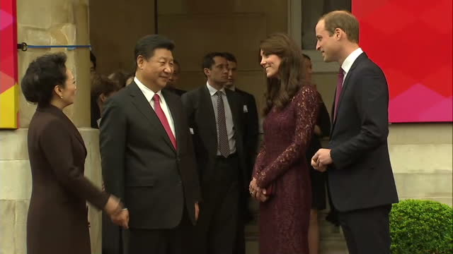 Exterior shots of Chinese premier Xi Jinping arriving in a car with wife Peng Liyuan and shaking hands with Prince William and Catherine Duchess of...