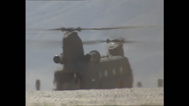 exterior shots of chinook helicopter taking off on 26th march 2002 in bagram airfield, afghanistan. - bagram stock videos & royalty-free footage