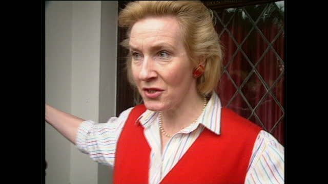 Exterior shots of Christine Hamilton Neil Hamilton's wife telling journalists to get off their property and fending off reporters outside their home...