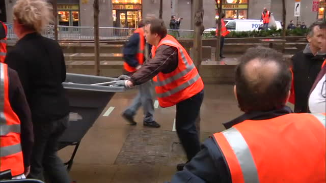 exterior shots of city workers in zuccotti park cleaning up debris from previous day's occupy wall street anti capitalist protest on october 14, 2011... - occupy protests stock videos & royalty-free footage