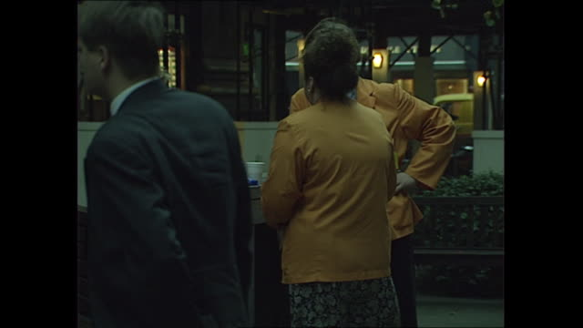exterior shots of city workers walking to work and city traders in coloured jackets drinking coffee outside building on 27 october 1989 in london... - 1980 1989 stock videos & royalty-free footage