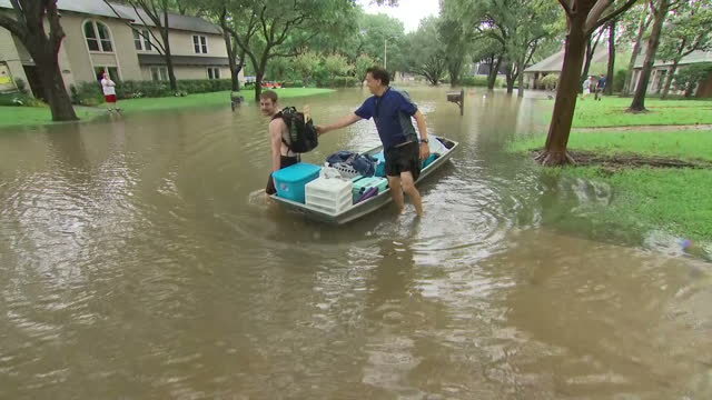 Exterior shots of civilians being evacuated after area flooded due to Hurricane Harvey on 29th August 2017 Houston Texas