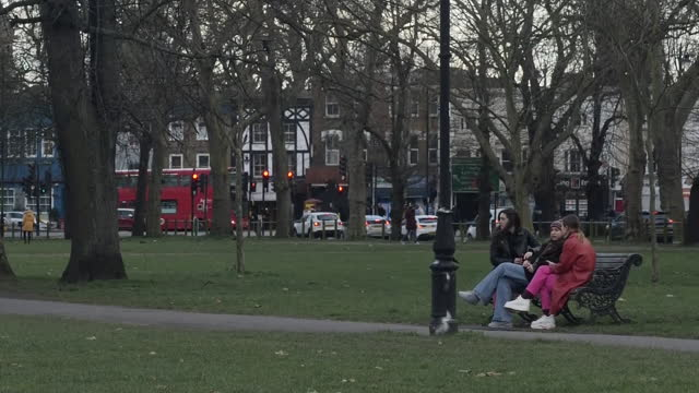 exterior shots of clapham common and people walking through park on 11th march 2021 in clapham, london, united kingdom. - walking stock videos & royalty-free footage